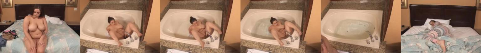 Gruba Katia robi sobie dobrze w wannie strumieniem wody